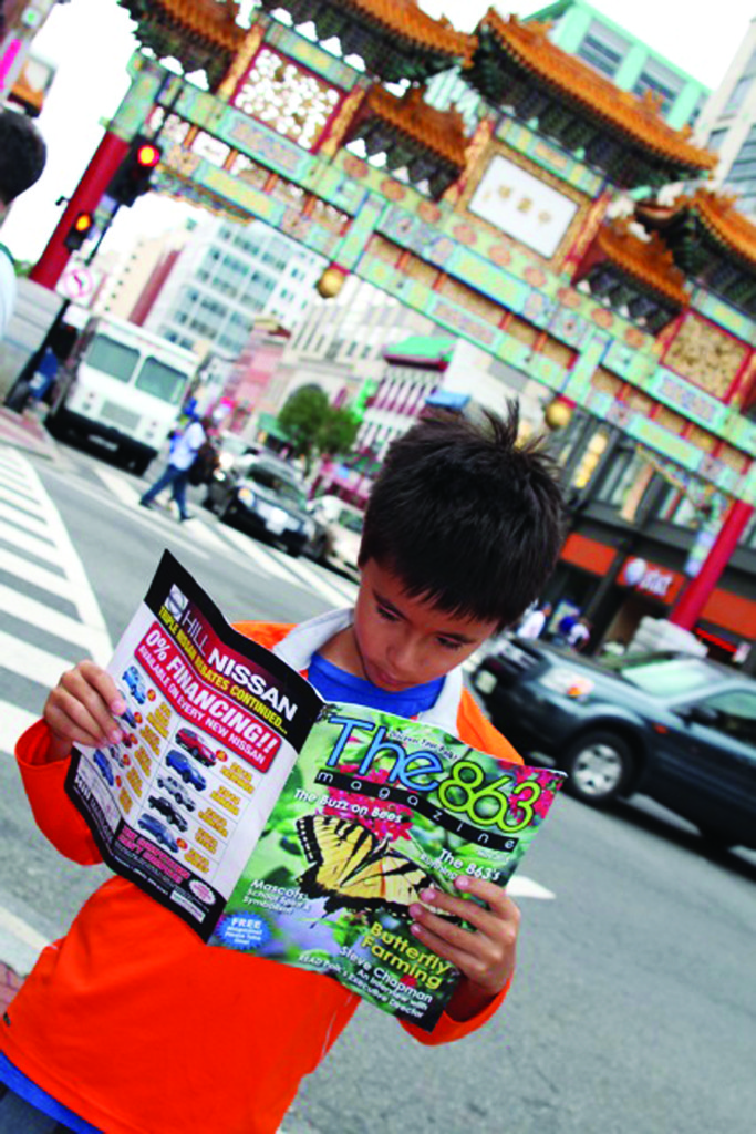Elijah Bauer reads the May 2014 issue while visiting Chinatown in Washington D.C.; submitted by Thanh Bauer. We love the composition and colors!