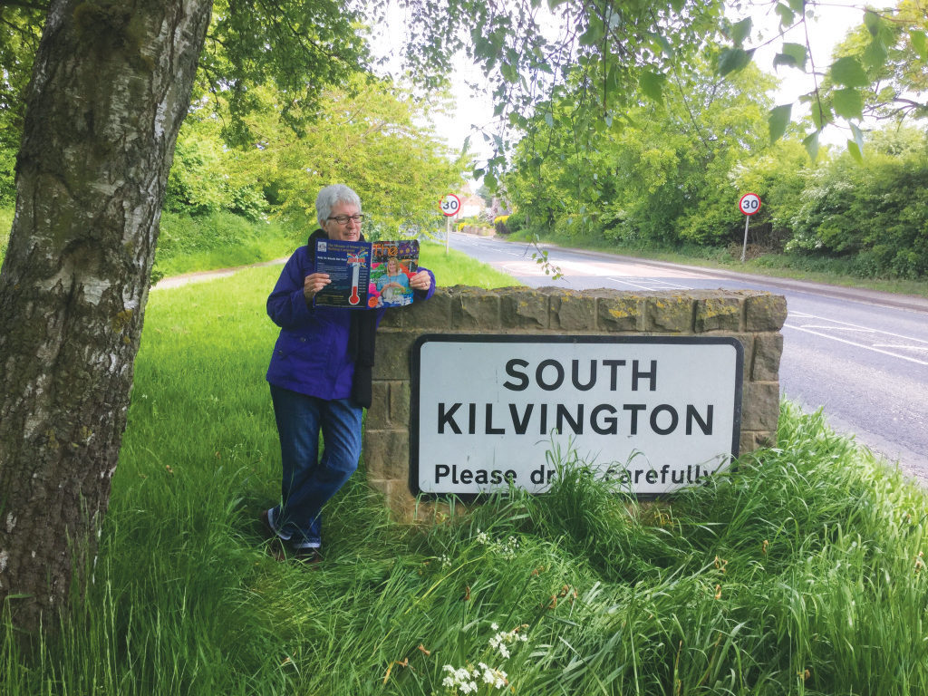 Second place was snatched up by Winter Haven's Jane Kilvington, who took The 863 to England and read her copy while in front of a village welcome sign that bears her last name. We dig her nonchalant pose.